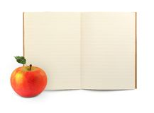 Exercise book and apple. Lined exercise book and apple on white, visible shadow in front Stock Images