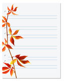 Exercise book with autumnal virginia creeper twig Royalty Free Stock Photos