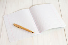 Exercise book jotter with pen. A blank exercise book jotter with pen Stock Photo