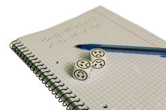Exercise book with mathemacical equation and dices with sad face Stock Photo