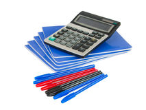 Exercise book with pen and calculator Stock Photo