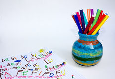 Exercise book and pen holder. Exercise book and ceramics pot with set of colored  felt-pen Stock Photos