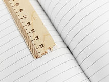 Exercise book and ruler Stock Image