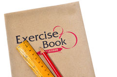 Exercise book with ruler and pencil Royalty Free Stock Photo