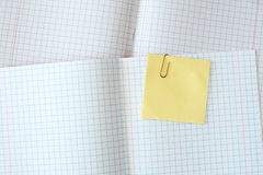 Exercise book with yellow sticky note Royalty Free Stock Photo