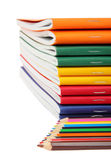 Exercise books and pencils Royalty Free Stock Images