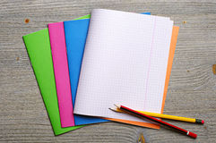 Exercise books and pencils Stock Image