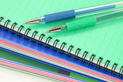 Exercise-books and pens Royalty Free Stock Images