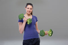 Exercise with broccoli dumbbell, symbol Stock Image