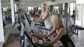 Exercise on cardio fitness equipment stock video footage