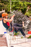 Hispanic Climber Training For Climbing Rope Competition Stock Photography