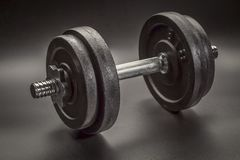 Exercise concept - iron dumbbell abstract Royalty Free Stock Photos