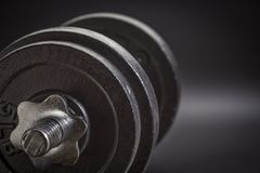 Exercise concept - iron dumbbell abstract Stock Image