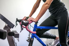 Exercise with cyclette. A young girl making exercise with the cyclette Stock Photography