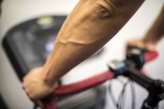 Exercise with cyclette. A young guy making exercise with the cyclette Royalty Free Stock Photos