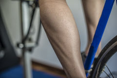 Exercise with cyclette. A young guy making exercise with the cyclette Royalty Free Stock Photo