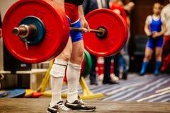 Exercise deadlift bar powerlifting. Legs powerlifter in socks exercise deadlift bar powerlifting Stock Photo