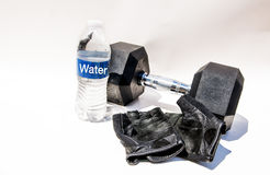 Exercise Daily. Diet and Exercise daily with water bottle and dumb bells Stock Photo
