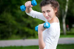 Exercise with dumbbell Stock Photography