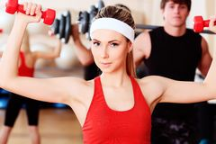 Exercise with dumbbells Stock Images