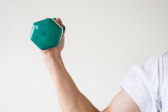 Exercise with dumbell. A man is exercising with a dumbell Royalty Free Stock Image