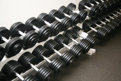 Exercise equipment. Neatly stored in a police gym Stock Photos