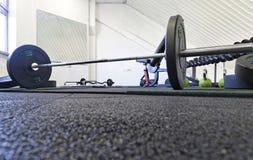 Exercise equipment in empty gym Stock Photos