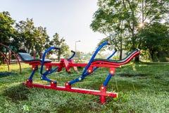 Exercise equipment in public park on sunrise. Stock Photos