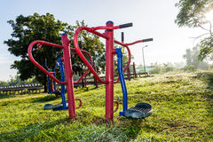 Exercise equipment in public park on sunrise. Stock Photo
