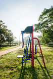 Exercise equipment in public park on sunrise. Stock Photography