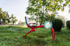 Exercise equipment in public park on sunrise. Royalty Free Stock Photography