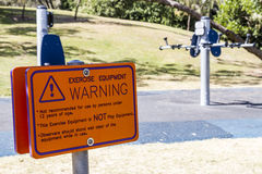 Exercise equipment warning sign. Sign warning of dangers of exercise equipment Royalty Free Stock Photos