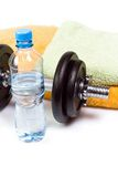 Exercise equipment, water and dumbbell Stock Photos