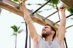 Exercise fitness athlete exercising on monkey bars Royalty Free Stock Images