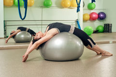 Exercise on fitness ball Royalty Free Stock Photography