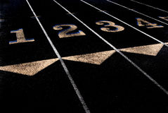 Exercise and Fitness Lanes of Track to Run. Lanes of a race track with numbers and lines royalty free stock images