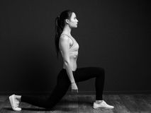Exercise and fitness - sports woman doing squat (lunge forward) Royalty Free Stock Photo