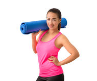 Exercise fitness woman ready for workout standing holding yoga m Royalty Free Stock Images
