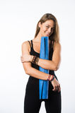 Exercise fitness woman ready for workout standing holding yoga mat isolated on white background. Sporty fit beautiful Stock Photos