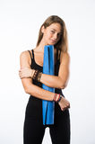 Exercise fitness woman ready for workout standing holding yoga mat isolated on white background. Sporty fit beautiful Stock Photography