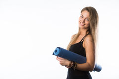 Exercise fitness woman ready for workout standing holding yoga mat isolated on white background. Sporty fit beautiful Royalty Free Stock Photo