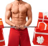 Sexy Santa Claus man with a barbell. Exercise guide. Cropped closeup shot of a man doing exercises with a barbell in studio isolated on white Stock Photography