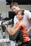 Exercise in health club Stock Photos