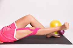 Exercise after leg injury with kinesio tape Royalty Free Stock Image