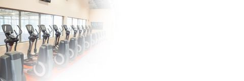 Exercise machines in Gym with transition. Digital composite of Exercise machines in Gym with transition Royalty Free Stock Images