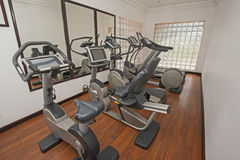 Exercise machines in private gym. Exercise machines in luxury private health center gym room Stock Photo