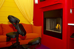 Exercise and massage cabana room with fireplace. Brightly colored exercise and massage cabana room with fireplace Stock Photography