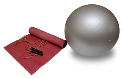 An exercise mat, ball and skipping rope Royalty Free Stock Image
