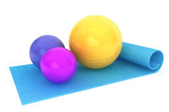 Exercise mat with colorful fitness balls Stock Photography