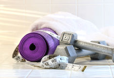 Exercise mat with weights Royalty Free Stock Images